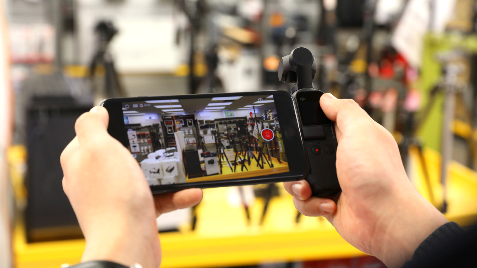 The DJI Osmo Pocket attached to smartphone