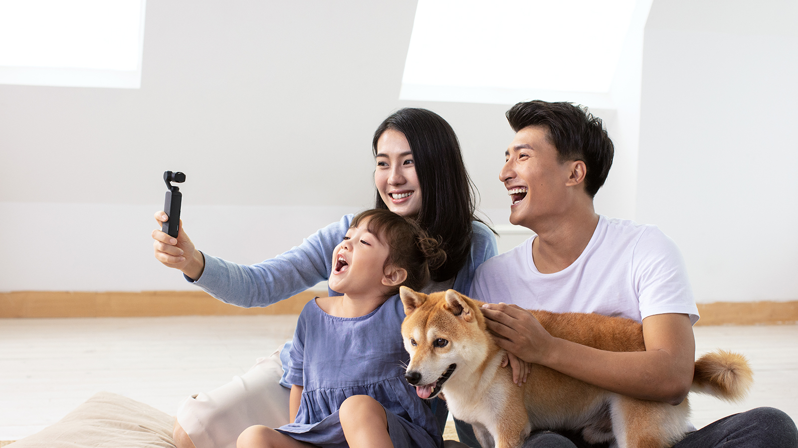 Family taking selfie with the DJI Osmo Pocket